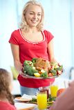 Woman with turkey Stock Image