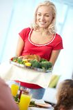 Woman with turkey Royalty Free Stock Image