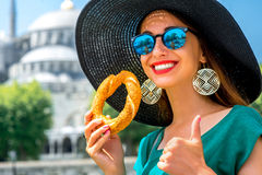 Woman with turkish bagel in Istanbul Royalty Free Stock Photography