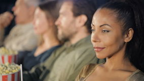 Woman turn her face at the movie theater stock footage
