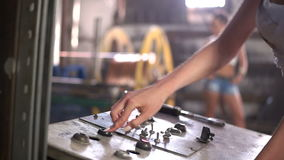 Woman turn on machine in the factory stock video footage