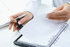 Woman turning notebook page Stock Photos
