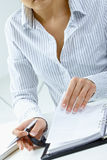 Woman turning notebook page Stock Photo