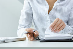 Woman turning notebook page Stock Image