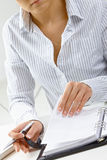 Woman turning notebook page Stock Images