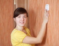 Woman turning off the light switch Stock Image