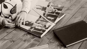 Woman reviewing pages of photo album. Woman turning the pages of a photo album, photography magazine stock video footage
