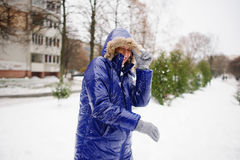 Woman turns aside from the snowballs flying to her. Royalty Free Stock Photo