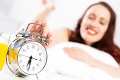 Woman turns off the alarm Royalty Free Stock Images