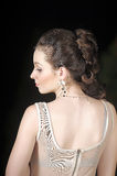Woman turns over her shoulder Royalty Free Stock Photo