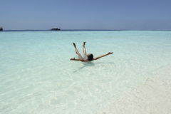 Woman in turquise water maldives Royalty Free Stock Photography