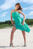 Woman in turquoise. On the beach royalty free stock images