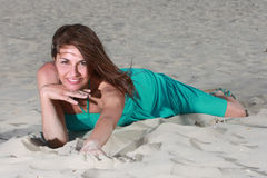 Woman in turquoise. On the beach Royalty Free Stock Photos