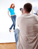Woman in turquoise blouse posing Stock Photography