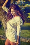 Woman in Tuscany garden. Romantic Woman in Tuscany garden royalty free stock photography