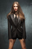 Woman in tuxedo jacket Stock Photos