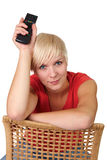 Woman with TV remote Royalty Free Stock Images