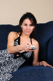 Woman With TV Remote Control Stock Photos