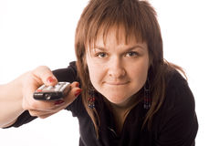 Woman with TV remote control Stock Photo