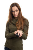 Woman with tv remote Stock Photo