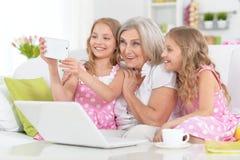 Woman with tweenie   girls doing selfie Stock Photography