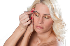 Woman with tweezers Royalty Free Stock Photography