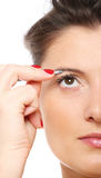 Woman with tweezers Royalty Free Stock Photo