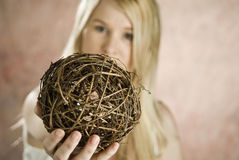 Woman with twig ball Stock Photos