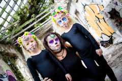 Woman and twin girls with sugar skull makeup Royalty Free Stock Images
