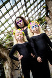 Woman and twins with halloween makeup Stock Images