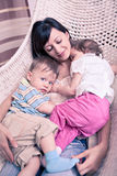 Woman with twins Stock Image