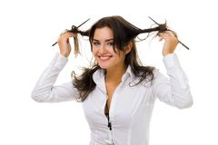 Woman twirl her hair with sticks. One young woman twirl her hair with sticks in white shirt smiling and looking at camera stock photography