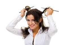 Woman twirl her hair with sticks. One young woman twirl her hair with sticks in white shirt smiling and looking at camera royalty free stock photos