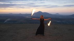 Woman twirling burning torch stock footage