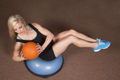 Woman twist ball fitness Stock Photography