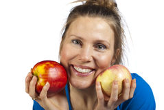 Woman and two apples Stock Photos