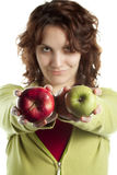 Woman with Two Apples Stock Photography