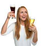 Woman with two beer mugs smiling yelling and looking at the corn Royalty Free Stock Image