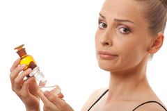 Woman with two bottles of medicine or perfume Stock Photos