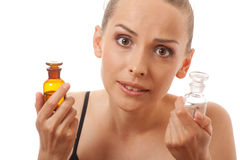 Woman with two bottles of medicine or perfume Royalty Free Stock Photos