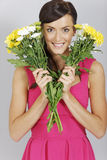 Woman with two bunches of flowers Stock Images
