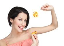 Woman with two candies Royalty Free Stock Photos