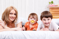 Woman and two children Stock Images