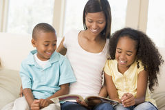Woman and two children sitting in living room Royalty Free Stock Photography