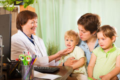 Woman of two children  talking with friendly  doctor Stock Photography