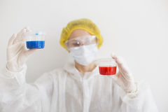Woman with two containers stock photography