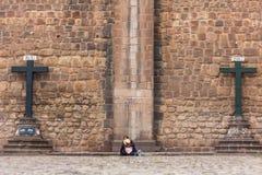 Woman between two crosses Cuzco Peru. Cuzco, Peru - July 16, 2013: woman sitting between two crosses stock images