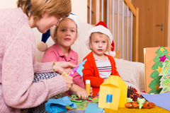 Woman with two daughters preparing for Christmas Stock Photos