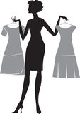 Woman with two dresses. A silhouette of a woman with two dresses on hangers Royalty Free Stock Photo