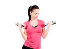 Woman with two dumbbells Royalty Free Stock Photography